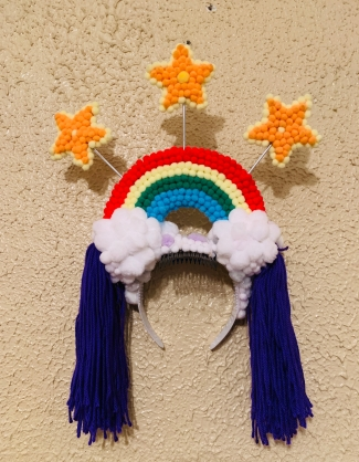 Rainbow Mardi Gras headpiece made from fuzzy pom-poms